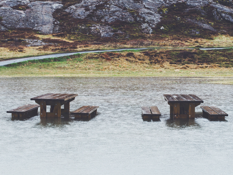 Picnic tables in flooded valley