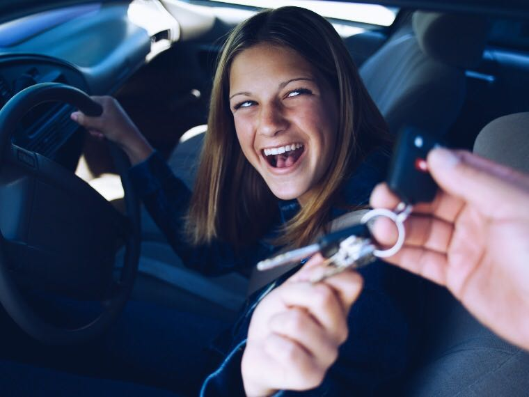 Teen driver excitedly reaching for car keys