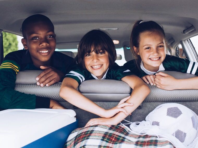 Three children in a car