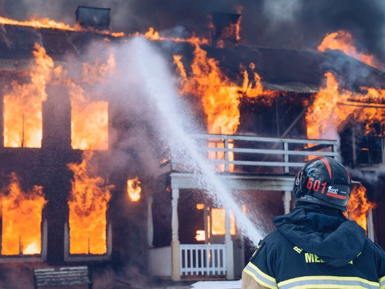 Firefighters putting out a severe house fire