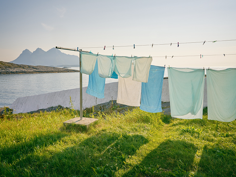 Sheets hang-drying on a clothes line