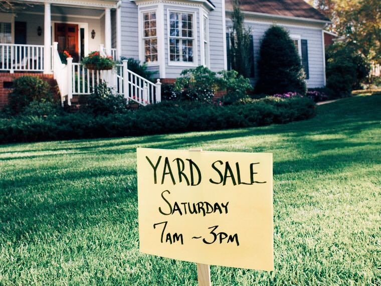 Yard sale sign in front yard